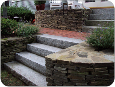 Picture of stone wall, granite steps, brick walkway